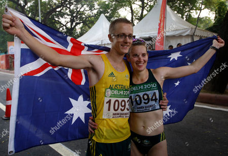 Jared Tallent, Claire Tallent Australia's Jared Tallent, gold medalist in the men's 20 km walk, and his wife Claire, silver winner in the women's 20 km walk, pose with their country flag during the Commonwealth Games in New Delhi, India