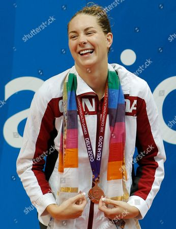 Canada's Julia Wilkinson reacts after receiving her bronze medal for the Women's 200m Individual Medley during the Commonwealth Games at the Dr. S.P. Mukherjee Aquatics Stadium in New Delhi, India