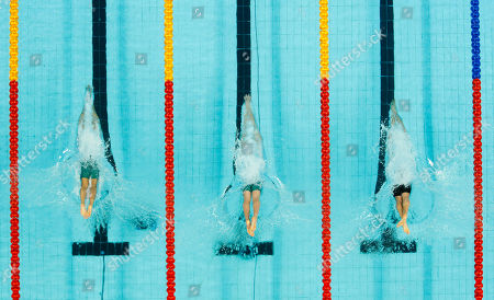 From left, Australia's Nicholas Ffrost, Australia's Thomas Fraser-Holmes, and Scotland's David Carry compete in a Men's 200m freestyle heat during the Commonwealth Games at the Dr. S.P. Mukherjee Aquatics Stadium in New Delhi, India