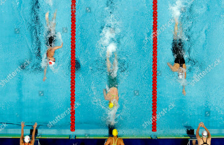 Australia's Kylie Plamer, center, swims against England's Joanne Jackson, right, and Canada's Genevieve Sammur during the 4x200 freestyle relay during the Commonwealth Games at the Dr. S.P. Mukherjee Aquatics Center in New Delhi, India