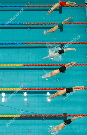 Swimmers dive into the pool in the 1500m freestyle final during the Commonwealth Games at the Dr. S.P. Mukherjee Aquatics Center in New Delhi, India, . From top, Richard Charlesworth of England, Ryan Napoleon of Australia, Ryan Cochrane of Canada, Mark Randall of South Africa, Daniel Fogg of England and Heerden Herman of South Africa. Cochrane won gold