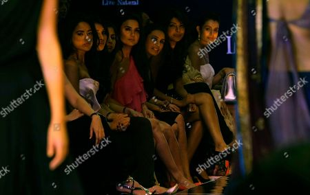 Bollywood actresses from right to left, Amisha Patel, Priyanka Chopra, Rani Mukharjee and Prity Zinta watch the collection of Manish Malhotra on the forth day of the Lakme Fashion Week in Mumbai, India