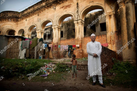 Jaffar Mir Abdullah Ibrahim Ali Khan stands outside the crumbling royal palace known as Sheesh Mahal, in Lucknow, Utter Pradesh, India. The tale begins in the 18th century, with an ancestor who served a Mogul emperor and an aristocratic family's rise to immense wealth and power. It ends with Khan and his brother-in-law, white-haired men living in adjoining apartments in a palace that long ago passed the point of crumbling, and both claiming the throne of a kingdom that hasn't existed for 150 years