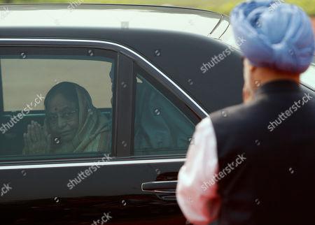 Pratibha Patil, Manmohan Singh Indian Prime Minister Manmohan Singh, right, looks, as Indian President Pratibha Patil, leaves after the ceremonial of Malawi President Bingu wa Mutharika, unseen, at the Rashtrapati Bhawan or Presidential Palace in New Delhi, India