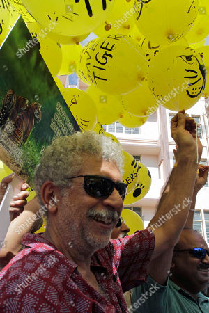 Naseeruddin Shah Bollywood actor Naseeruddin Shah releases balloons during an awareness rally for global climatic change and extinction of Royal Bengal tigers from Sunderban delta, in Calcutta, India, . The Sunderbans, about 3,860 square miles of marshlands and mangrove forests along the coast of the Bay of Bengal, is one of the few remaining natural tiger habitats in India. Tigers have been slowly disappearing from forests and reserves in India due to poaching, tourism and a shortage of properly trained forest guards