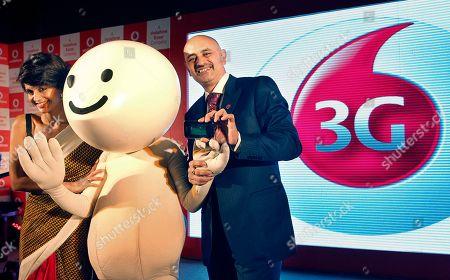 "Sanjoy Mukerji, Mandira Bedi Vodafone India Business Operations head Sanjoy Mukerji, right, and Bollywood actress Mandira Bedi pose along with ""Zoozoo,"" Vodafone's advertisement character, at a demonstration of its 3G services at a press briefing in New Delhi, India"