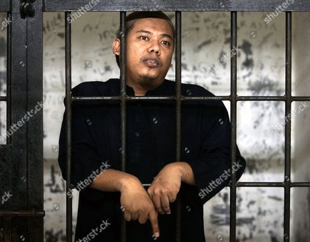 Stock Picture of Mohammed Sofyan Tsauri Mohammed Sofyan Tsauri, who is accused of involvement in plots targeting foreigners and Western embassies in the country, waits behind bar to his first trial on at a district court in Depok, Indonesia. The former police officer says he helped al-Qaida train 170 members of new terror cell in westernmost Aceh province soon after he defected from the force