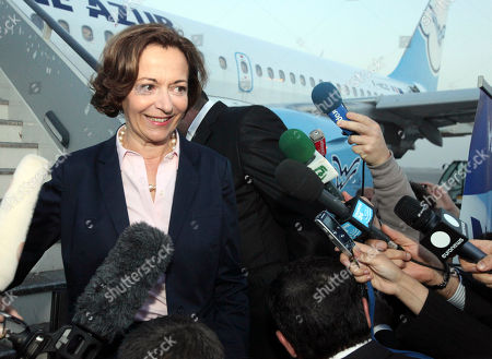 French Minister of Foreign Trade Anne Marie Idrac disembarks from France's Aigle Azur airlines plane in Baghdad, Iraq, . The French airline has landed in Baghdad international airport, becoming one of the first passenger carriers to fly into the capital direct from western Europe since the Gulf War and opening a potential new route to stronger international business ties