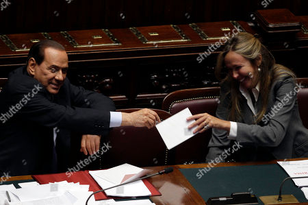 Italian Premier Silvio Berlusconi shares a light moment with Environment Minister Stefania Prestigiacomo, at the lower house of parliament, in Rome, . Silvio Berlusconi is setting out his agenda before lawmakers ahead of a confidence vote that will determine the survival of his government. The Italian leader is expected to survive the confidence vote in the lower house of parliament later Wednesday. But if he loses, he will have to resign. Berlusconi is halfway through his current five-year term. The premier split with longtime lieutenant Gianfranco Fini this summer after months of feuding over the government's program and the balance of power in the party the two co-founded