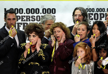 From left, actor Raul Bova and Gina Lollobrigida blow whistles as Susan Sarandon blocks her ears, on the occasion of the World Food Day, at the FAO (United Nations Food and Agriculture Organization) headquarters in Rome