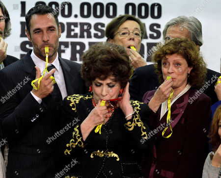 Italian actor Raul Bova, left, Gina Lollobrigida, foreground, center, and Susan Sarandon, right, blow whistles after being named FAO goodwill ambassadors on the occasion of the World Food Day, at the FAO (United Nations Food and Agriculture Organization) headquarters in Rome