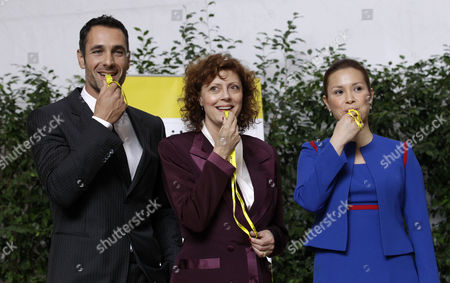 Actress Susan Sarandon, center, Italian actor Raul Bova, left, and Filipino singer and actress Lea Salonga blow whistles after being named new FAO goodwill ambassadors, on the occasion of the World Food Day, at the FAO (United Nations Food and Agriculture Organization) headquarters in Rome