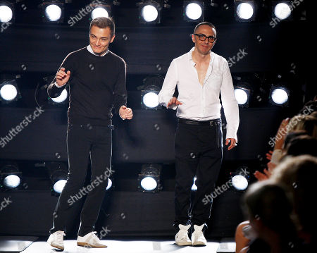 Italian fashion designers Tommaso Aquilano, right, and Roberto Rimondi acknowledge the applause of the audience after presenting the Ferre' Spring-Summer 2011 fashion collection, during the fashion week in Milan, Italy
