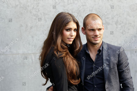 Wesley Sneijder, Yolanthe Cabau Inter Milan soccer player Wesley Sneijder of The Nederlands with his wife Yolanthe Cabau pose prior to the presentation of the Armani Spring-Summer 2011 fashion collection, during the fashion week in Milan, Italy