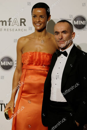 French supermodel Nadege du Bospertus and her hausband Arturo Cazzaniga attend the 'Amfar', foundation for Aids research, second annual benefit held in conjunction with Milan fashion week, in Milan, Italy