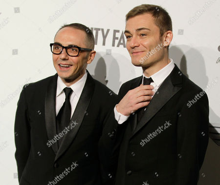 Tommaso Aquilano, Roberto Raimondi Tommaso Aquilano, left and Roberto Raimondi creative directors of the Gianfranco Ferre' fashion group attend the 'Amfar', foundation for Aids research, second annual benefit held in conjunction with Milan fashion week, in Milan, Italy