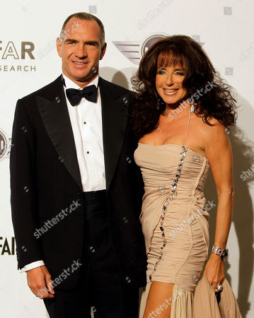 Sergio Dompe', Gabriella Dompe Italian president of Farmindustria group, Sergio Dompe' and his wife Gabriella attend the 'Amfar', foundation for Aids research, second annual benefit held in conjunction with Milan fashion week, in Milan, Italy