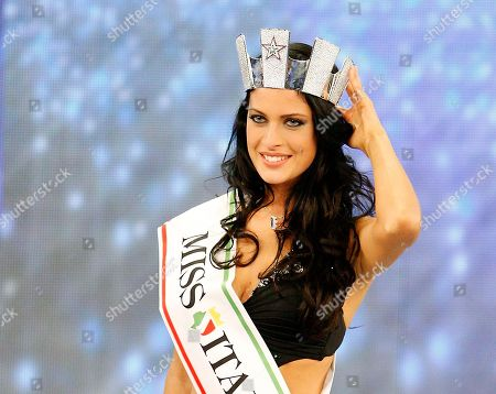 Francesca Testasecca reacts after she was voted Miss Italia (Miss Italy) 2010, in Salsomaggiore, Italy