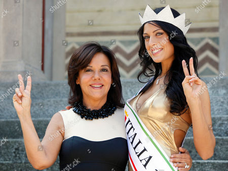 Miss Italia (Miss Italy) 2010 Francesca Testasecca, right, poses during a photo call with Patrizia Mirigliani, in Salsomaggiore, Italy, the day after her election