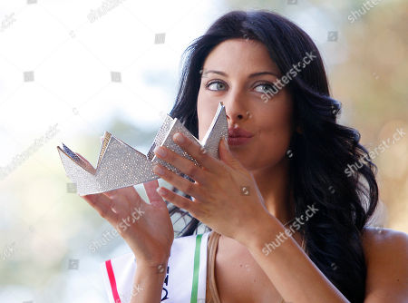 Miss Italia (Miss Italy) 2010 Francesca Testasecca kisses the crown as she poses during a photo call, in Salsomaggiore, Italy, the day after her election