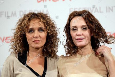 """Actresses Valeria Golino, left, and Antonella Ponziani pose for a photo call to present the movie """"La scuola e' finita"""" during the Rome Film Festival at Rome's Auditorium"""