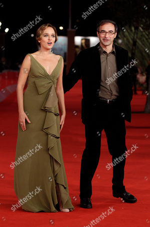"""Actress Valeria Golino, left, arrives on the red carpet flanked by director Valerio Jalongo to present the movie """"La scuola e' finita"""" during the Rome Film Festival at Rome's Auditorium"""