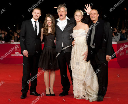 """Tambet Tuisk, Paula Beer, Chris Kraus, Jeannette Hain, Edgar Selge From left, actor Tambet Tuisk, actress Paula Beer, director Chris Kraus, actress Jeannette Hain and actor Edgar Selge pose as they arrive on the red carpet of their movie """"The poll diaries"""" during the Rome Film Festival at Rome's Auditorium"""