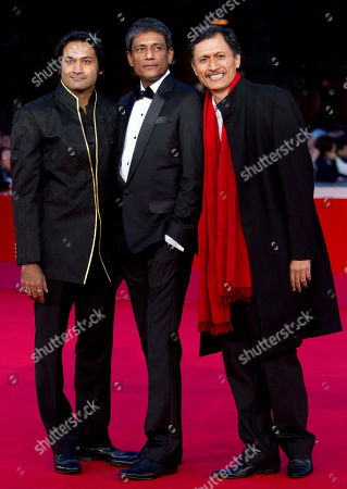 """Samrat Chakrabarti, Adil Hussain, Dibang From left, actors Samrat Chakrabarti, Adil Hussain and Dibang arrive on the red carpet to attend the screening of their movie """"Gangor"""" during the Rome Film Festival at Rome's Auditorium"""