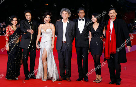 "Tillotama Shome, Samrat Chakrabarti, Priyanka Bose, Italo Spinelli, Adil Hussain, Seema Rahmani, Dibang From left, actress Tillotama Shome, actor Samrat Chakrabarti, actress Priyanka Bose, director Italo Spinelli, actor Adil Hussain, actress Seema Rahmani and actor Dibang pose as they arrive on the red carpet of their movie ""Gangor"" during the Rome Film Festival at Rome's Auditorium"