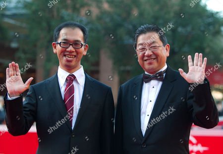 """Cartoonist and director Hiromasa Yonebayashi, left, and producer Koji Hoshino arrive on the red carpet to present the movie """"Karigurashi no Arrietty"""" during the Rome Film Festival at Rome's Auditorium"""