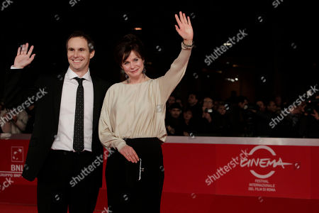 """Emily Watson, Jim Loach Director Jim Loach and actress Emily Watson wave to photographers as they walk on the red carpet to attend the screening of their movie """"Oranges and Sunshine"""" during the Rome Film Festival at Rome's Auditorium"""