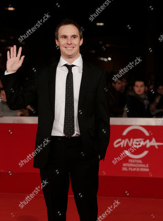 """Jim Loach Director Jim Loach waves as he arrives on the red carpet to attend the screening of his movie """"Oranges and Sunshine"""" during the Rome Film Festival at Rome's Auditorium"""