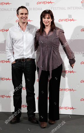 """Jim Loach, Emily Watson Director Jim Loach, left, and actress Emily Watson pose for photographers during a photocall to present the movie """"Oranges and Sunshine """" during the Rome Film Festival at Rome's Auditorium"""