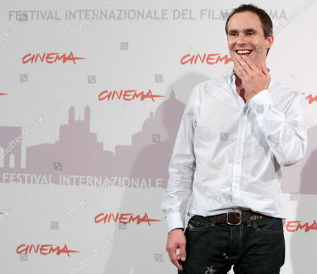 """Jim Loach Director Jim Loach reacts during a photocall to present the movie """"Oranges and Sunshine """" during the Rome Film Festival at Rome's Auditorium"""