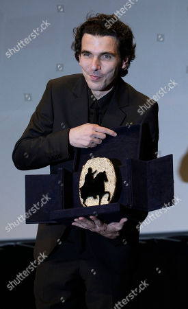 """Stock Image of Olias Barco Belgian director Olias Barco, holds the best movie prize for """"Kill me please"""" during the awarding ceremony of the Rome Film Festival at Rome's Auditorium"""