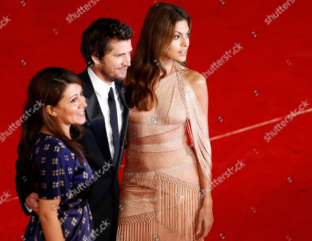 """Eva Mendes, Massy Tadjedin, Guillaume Canet From left, Iranian-American director Massy Tadjedin, French actor Guillaume Canet, and US actress Eva Mendes arrive to attend the screening of the movie """"La petit Mouchoirs"""" during the Rome Film Festival at Rome's Auditorium"""