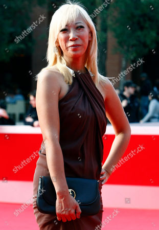 """Japanese photographer Mika Ninagawa smiles on the red carpet prior to the presentation of her movie """"Sakuran"""" during at the Rome Film Festival, at Rome's Auditorium"""