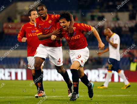 Nicolas Burdisso, Juan Silveira Dos Santos AS Roma's Nicolas Burdisso of Argentina, right, celebrates with his teammate Brazilian defender Juan Silveira Dos Santos after he scored during a Serie A soccer match between AS Roma and Lecce, at Rome's Olympic stadium