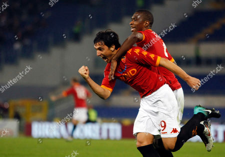 Nicolas Burdisso, Juan Silveira Dos Santos AS Roma's Nicolas Burdisso of Argentina, left, celebrates with his teammate Brazilian defender Juan Silveira Dos Santos after he scored during a Serie A soccer match between AS Roma and Lecce, at Rome's Olympic stadium