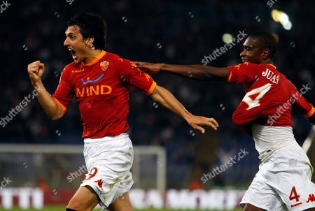 Stock Image of Nicolas Burdisso, Juan Silveira Dos Santos AS Roma's Nicolas Burdisso of Argentina, left, celebrates with his teammate Brazilian defender Juan Silveira Dos Santos after he scored during a Serie A soccer match between AS Roma and Lecce, at Rome's Olympic stadium
