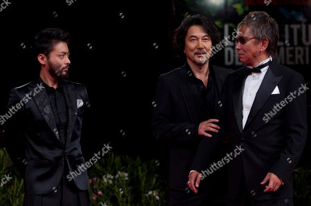 Actor Takayuki Yamada, actor Koji Yakusho and director Takashi Miike arrive for the screening of the film Jusan Nin No Shikaku (13 Assassins) at the 67th edition of the Venice Film Festival in Venice, Italy