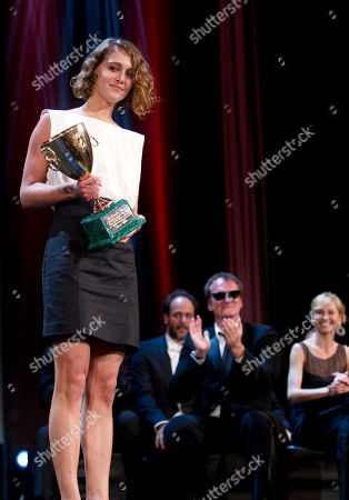 Ariane Labed, Luca Guadagnino, Quentin Tarantino, Ingeborga Dapkunaite Actress Ariane Labed with the trophy for Best Actress, being applauded by jury members in the background from left Luca Guadagnino, Quentin Tarantino and Ingeborga Dapkunaite at the Award Ceremony at the 67th edition of the Venice Film Festival in Venice, Italy