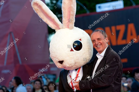 Takashi Shimizu, Dario Argento Directors Takashi Shimizu, wearing a mock rabbit head, and Dario Argento, right, arrive for the screening of the film Barney's Version at the 67th edition of the Venice Film Festival in Venice, Italy