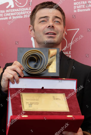Aureliano Amadei Director Aureliano Amadei poses with the prize receivd for his film 20 Sigarette (20 Cigarettes) during the photo call for the Controcampo Italiano Award at the 67th edition of the Venice Film Festival in Venice, Italy