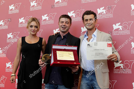 Carolina Crescentini, Aureliano Amadei, Vinicio Marchioni From left, actress Carolina Crescentini, director Aureliano Amadei and actor Vinicio Marchioni pose with the prize receivd for their film 20 Sigarette (20 Cigarettes) during the photo call for the Controcampo Italiano Award at the 67th edition of the Venice Film Festival in Venice, Italy