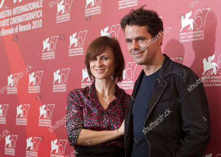 Sophie Rois, Tom Tykwer Actress Sophie Rois and director Tom Tykwer pose at the photo call for the film Drei at the 67th edition of the Venice Film Festival in Venice, Italy