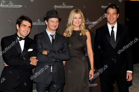 From left, Jaeger-LeCoultre CEO Jerome Lambert and actors Jeremy Renner, Rosamund Pike and Clive Owen arrive at the Jaeger Le Couture party during the 67th edition of the Venice Film Festival in Venice, Italy