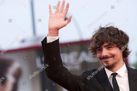 Edoardo Natoli Actor Edoardo Natoli waves as he arrives for the screening of the film Noi Credevamo at the 67th edition of the Venice Film Festival in Venice, Italy