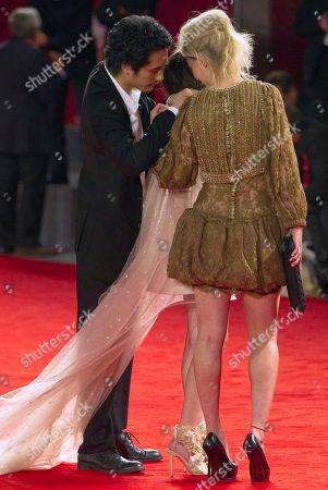 Kiko Mizuhara, Rinko Kikuchi, Kenichi Matsuyama Actress Kiko Mizuhara's dress is inspected by actor Kenichi Matsuyama, left, and actress Rinko Kikuchi, right, as they arrive for the screening of the movie Norwegian Wood at the 67th edition of the Venice Film Festival in Venice, Italy