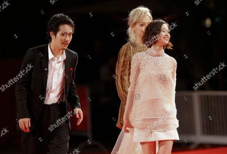 Kiko Mizuhara, Rinko Kikuchi, Kenichi Matsuyama From left, actor Kenichi Matsuyama, actresses Rinko Kikuchi and Kiko Mizuhara arrive for the screening of the movie Norwegian Wood at the 67th edition of the Venice Film Festival in Venice, Italy